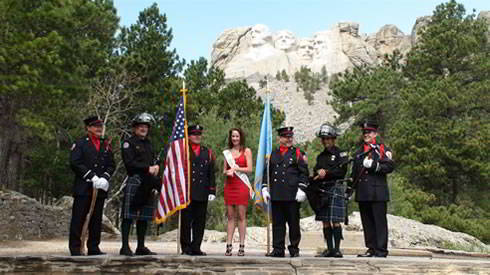 Anna Simpson Miss South Dakota 2011 with Police and Firefighters