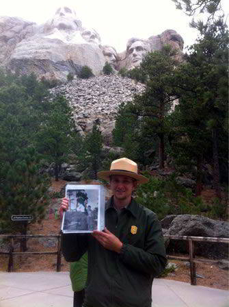Ranger Andy Frieder holding a picture of his grandfather with Gutzon Borglum